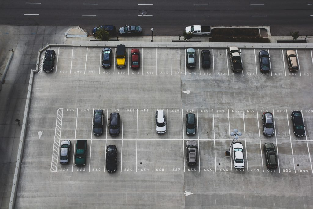aerial view of outdoor parking lot with cars