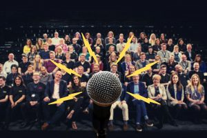 microphone with lightning in front of audience